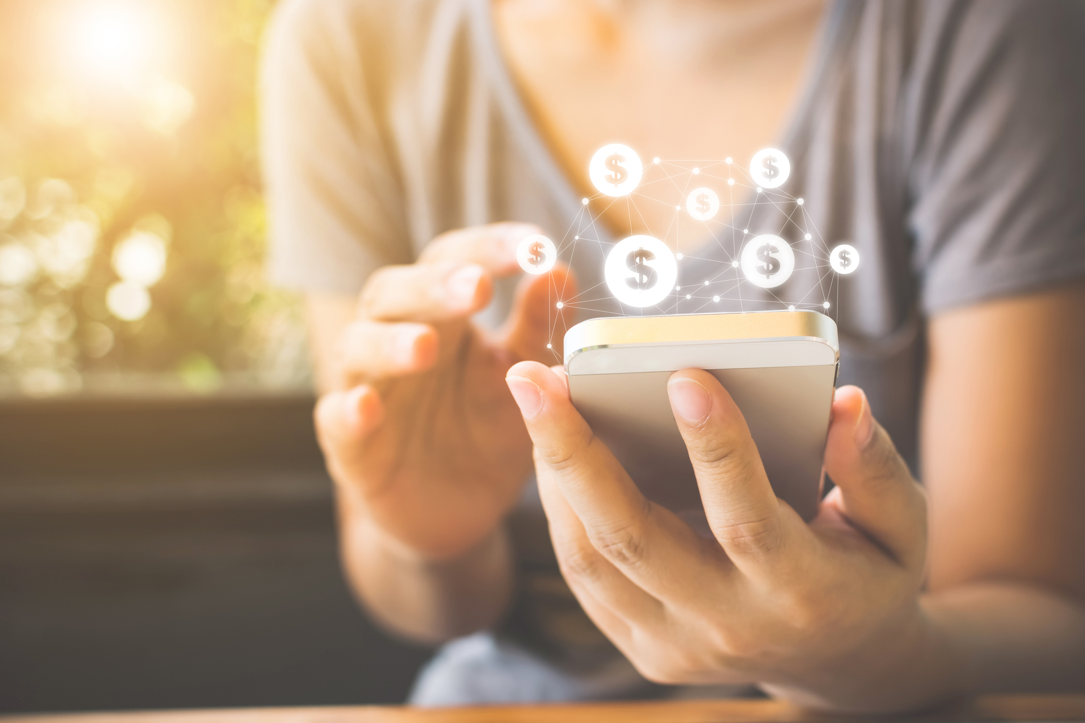 Woman hand using mobile phone with online transaction application, Concept e-commerce and internet investment